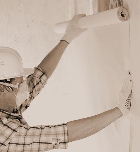 Man Installing Wallpaper